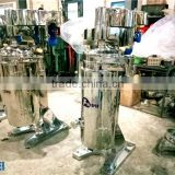 Tubular bowl centrifuge used for oil water separation in coconut oil mill