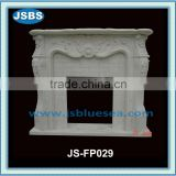 Hand carved stone fireplace surround