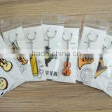 Made In China Differents designs music instrument shape silicone keychain.