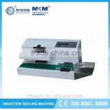 Popular semi-auto bottle cap induction sealing machine with reasonable price LGYF-2000AX