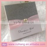Beautiful fold silver glitter wedding invitation cards with pink ribbons and pearl decoration                                                                         Quality Choice