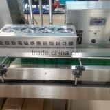 Factory supply automatic 4-head linear aluminum foil sealing machine for plastic bottles sale