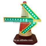 LED flashing directional arrow sign used on traffic cone