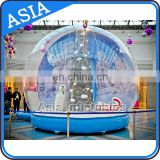 Large Human Snowing Snow Globe with Christmas Tree Backdrop, Advertising Exhibition Outdoor Christmas Decoration Giant Snow Glob