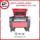 Jinan co2 mini fabric laser cutting machine price for acrylic wood leather/small cnc laser engraver and cutter machinery