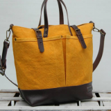 yellow waxed canvas bag with leather handles
