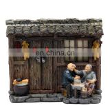 rustic style one old couple sitting on the door with happy figure for souvenirsaries