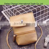Wholesale solid color girls pu shoulder bag with magnetic snap closure
