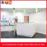 White cash wrap counter for store