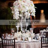 Centerpiece flower arrangement with white orchids cascading over the side, dripping crystal beads and roses