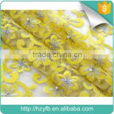 Alibaba china 3d flower lace embroidery fabric dubai wholesale fashion yellow purple french tulle beaded lace for evening dress