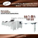 Machine For Chocolate Depositing And The Making Of Double Color, Center Filling, Nut Inclusion Chocolate