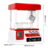 Children loved indoor coin operated claw crane machine game with music