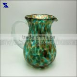 mottled green and golden recycled glass water jars