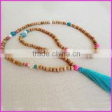NE2167 Fashion wooden bead tassel necklace with cross and a silky teal tassel