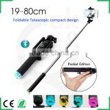 high-end innovative design travel snapshot camera tripod folding bluetooth selfie stick monopod for ios android smartphones