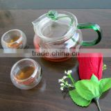 2012 fashionable Handmade process Eco-friendly Pyrex glass teapot set with green handle and flower lid