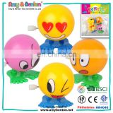 Wholesale cheap plastic wind up toys running ball with happy face design