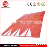 Red and black rubber road speed bump