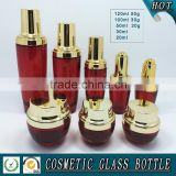 Red colored glass cosmetic bottle packaging and cosmetics cream empty jars