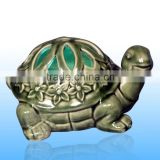 Ceramic tortoise shape battery operated luminary with inner color changing led candle for night decoration