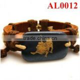 Unique bracelet, leather bracelet with cord connecting an ox bone carved lion AL0012