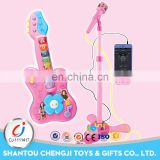 Plastic battery operated lighting musical toys for kids guitar with microphone
