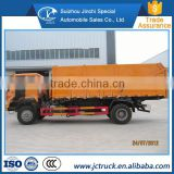 The remote control Waste compression station china howo 4x2 butt joint dump garbage truck Promotion price
