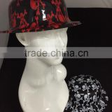 plastic fedora hats with halloween skeleton printed on the surface