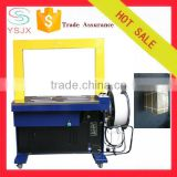 Arched automatic PP band carton rolling belt strapping machine