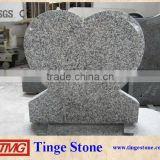 Grey granite monument carved heart designs