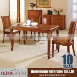 Fixed restaurant dining table by carved wood furniture