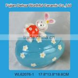 Blue easter ceramic storage jar with rabbit figurine