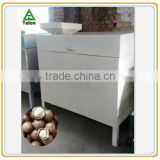Macadamia nut cracker machine nuts processing machine in Vietnamese