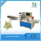China small Horizontal flow packing machine Manufacture for biscuits/bread/cake