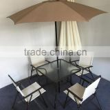 Patio Square Bar Dining Table with garden umbrella and folding chairs