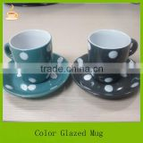 Samll size porcelain coffee mug with saucer set, black and green color glazed with white dots