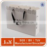 printed souvenir paper bags with hole handles                                                                         Quality Choice