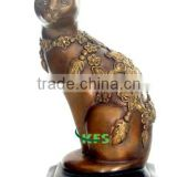 Bronze sculpture of cat with flower carving