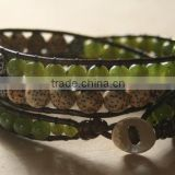 Jade, Sterling Silver, Triple Wrap Leather Beaded Bracelet. Green Jade, Lotus Seed, and Filigree Beads. Sterling Button