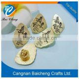 butterfly cap metal emblems/badges with high fashion black letter engraved in competitive price for sale in China
