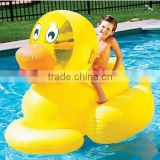 Water Children mounts inflatable yellow duck.