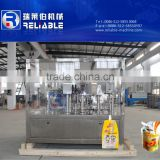 Stand up spout pouch filling and sealing machine