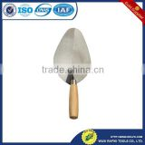 Professional construction tools brick with wood handle trowel