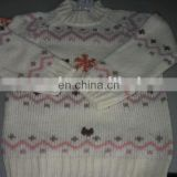 Colorful kids knitting pattern sweater with snowflakes and penguin for Christmas