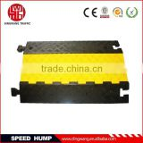 Road safety rubber cable protector hump