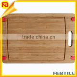 Nonslip Bamboo Cutting Board Conveniently sized heavy-duty wooden chopping board with handle, nonskid tabs and juice groove