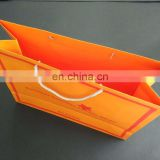 Larger orange Paper Clothing Bag With Cotton Handle