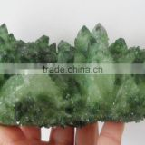 Natural small pyramid end prism with dark green point green crystal cluster covered with rime