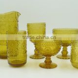 press glass drinkingware/Wine goblet,Hiball,tumbler, sundae cup,pitcher in Amber color with sunflower embossed patern